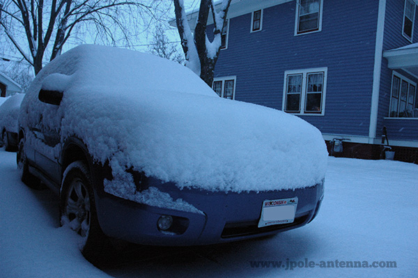 Snow covered car winter storm northern wisconsin