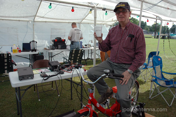Dennis again showing off the bicycle generator for natural power QSOs.